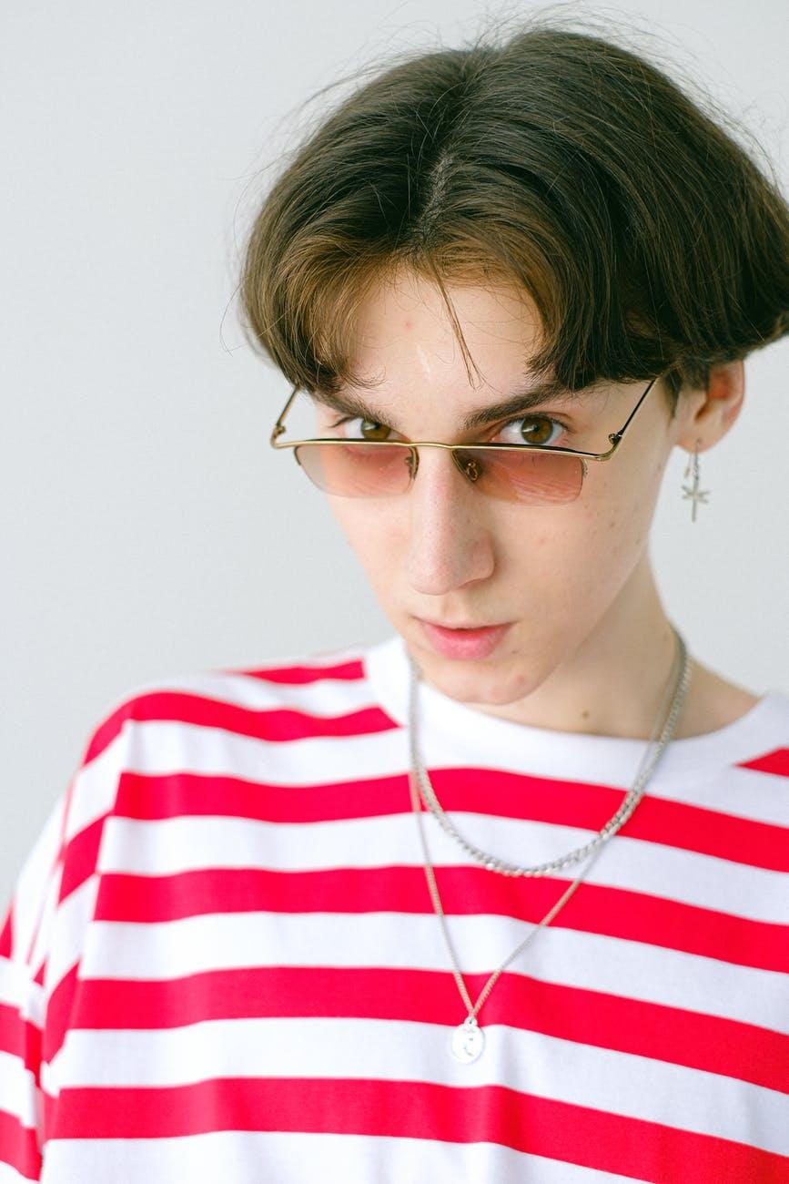teenage boy in eyeglasses with short hair