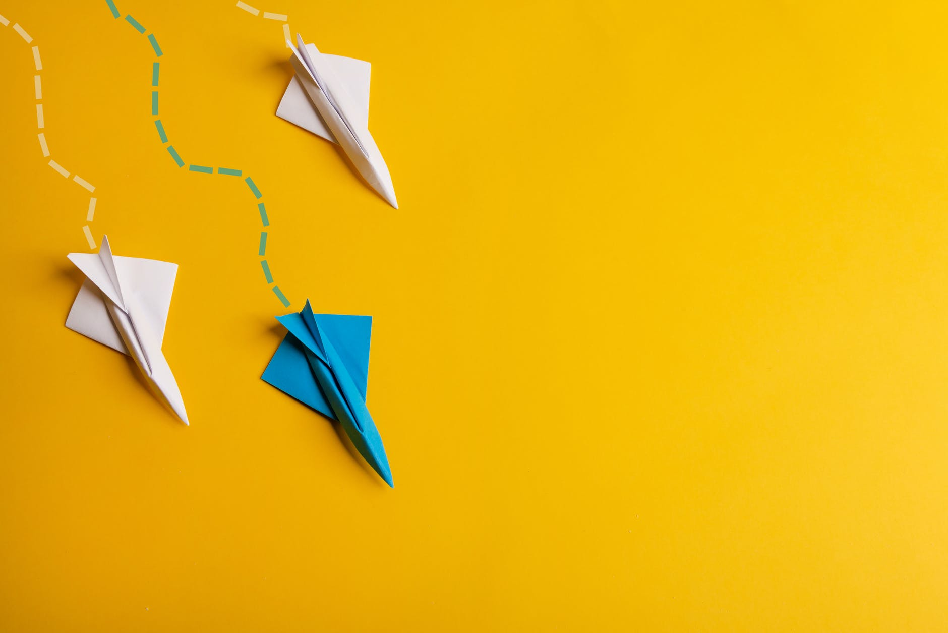 paper planes flying with traces